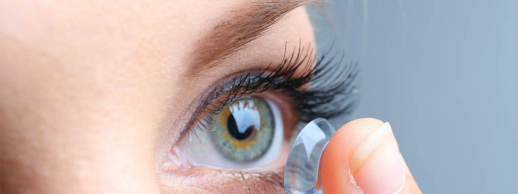 woman inserting contact lenses - optometrist - Colorado Springs, CO